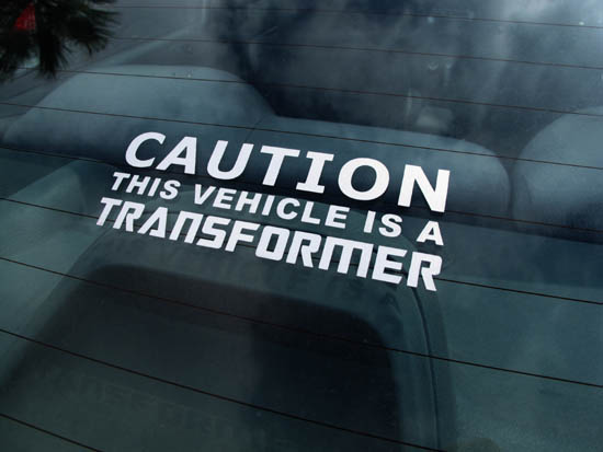 funny caution this vehicle is a transformer die cut car decals. Black Bedroom Furniture Sets. Home Design Ideas